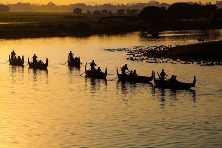 Silhouette of Tourist Boats at U bein bridge ,Amarapura ,Mandalay, Myanmar