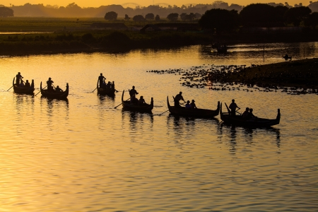 Silhouette of Tourist Boats at U bein bridge ,Amarapura ,Mandalay, Myanmar   photo