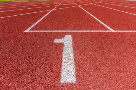 one lane: Number one on athletics all weather running track  Stock Photo