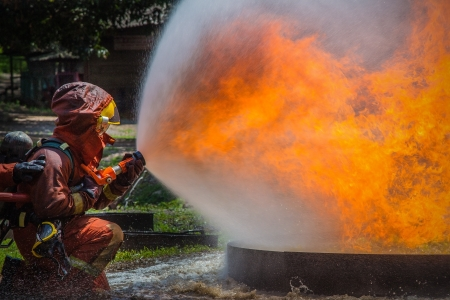 Firefighter fighting For A Fire Attack, During A Training Stock Photo - 20364069