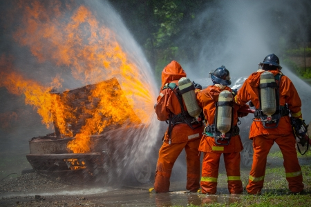 Firefighter fighting For A Fire Attack, During A Training  Imagens