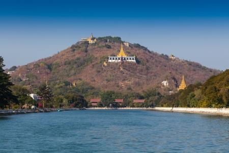banian: Golden pagoda in sagaing hill, Mandalay, myanmar.  Stock Photo