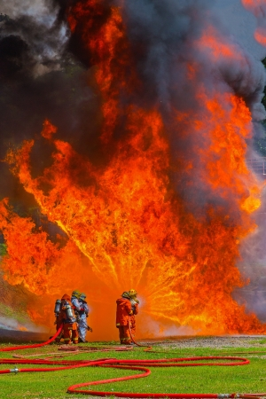 Firefighters fighting fire during training  photo