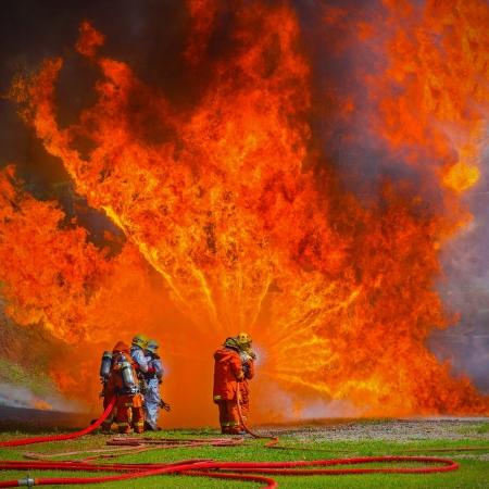 Firefighters fighting fire during training  Standard-Bild