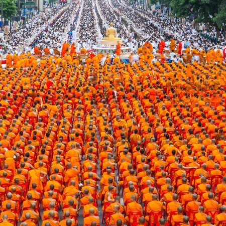 harity event: BANGKOK , THAILAND - September 8 : 10,000 Buddhist monks waiting for people give food offerings on September 8, 2013 Pratunam in Bangkok, Thailand.