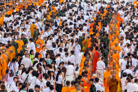 harity event: BANGKOK , THAILAND - September 8 : unidentified people give food and drink for alms to 10,000 Buddhist monks on September 8, 2013 Pratunam in Bangkok, Thailand.