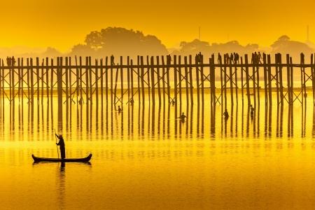 Sunset in U Bein bridge, Myanmar. U Bein bridge is longest teak bridge in the world.  photo