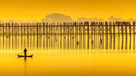 longest: Sunset in U Bein bridge, Myanmar. U Bein bridge is longest teak bridge in the world.