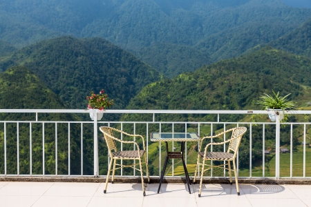 tables and chairs on terrace and nice view over the mountain in Sapa, Vietnam photo