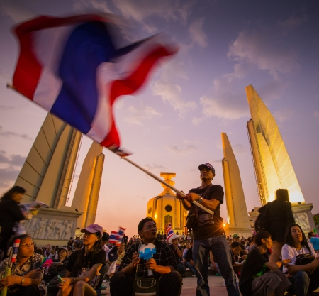af: BANGKOK,THAILAND- NOVEMBER 4 : Unidentified protesters protest by against the government corruption and the controversial amnesty bill at Democracy monument, on November 4, 2013 in Bangkok THAILAND  Editöryel