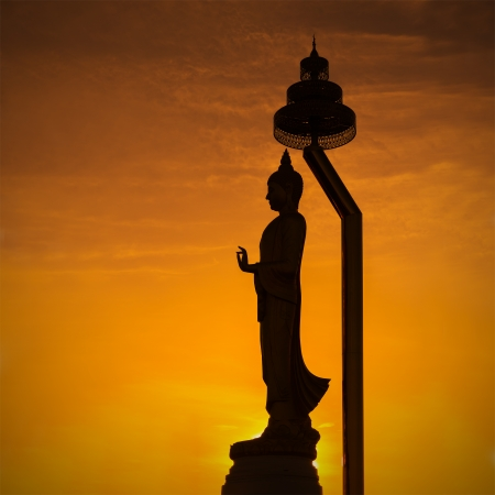 Silhouette of standing Buddha statue  photo