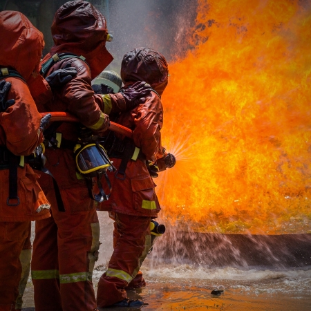 Firefighter fighting For A Fire Attack, During A Training Stock Photo - 23988328