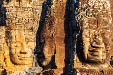 Faces of King Yayavarmann VII on the beautiful Bayon temple, Angkor Wat, Cambodia