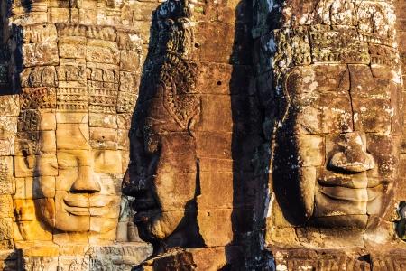 Faces of King Yayavarmann VII on the beautiful Bayon temple, Angkor Wat, Cambodia Stock Photo - 24431775