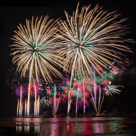 multiples: Fireworks of multiples colors with reflections on water