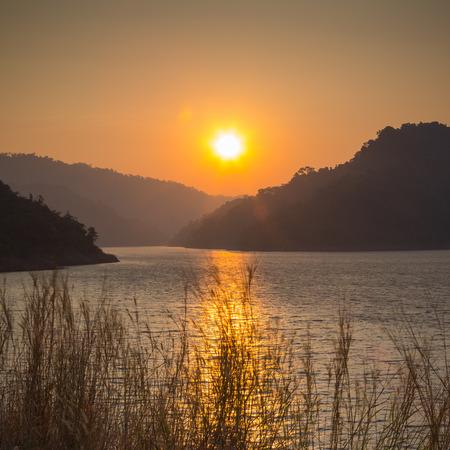 Rising sun at dawn over the mountain of Khundanprakanchon dam, Nakhon Nayok, Thailand  photo