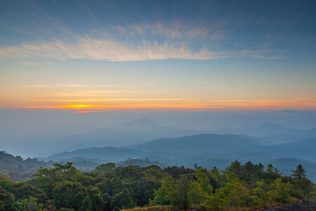 highlands region: The morning sky and fog on the Tropical Mountain Range,Thailand  Stock Photo