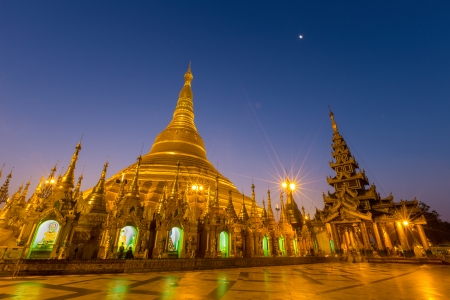 Shwedagon Pagoda Temple shining in the beautiful sunset in Yangon, Myanmar (Burma)  photo