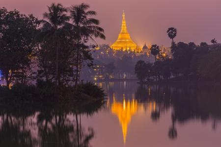 stupas: Shwedagon Pagoda in Yangon City, Burma at twilight