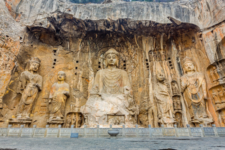 chinese temple: Longmen Grottoes with Buddhas figures are Starting with the Northern Wei Dynasty in 493 AD. It is one of the four notable grottoes in China.