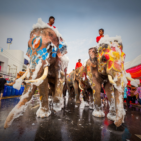 13 15 years: AYUTTAYA, THAILAND - APRIL 13: Songkran Festival is celebrated in a traditional New Years Day from April 13 to 15, with the splashing water with elephants on April 13, 2014 in Ayuttaya, Thailand.