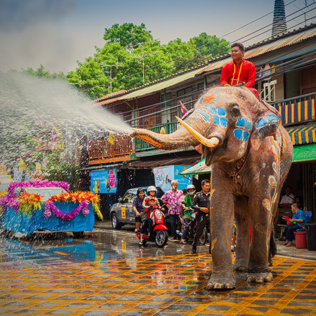 AYUTTAYA, THAILAND - APRIL 13: Songkran Festival is celebrated in a traditional New Years Day from April 13 to 15, with the splashing water with elephants on April 13, 2014 in Ayuttaya, Thailand.