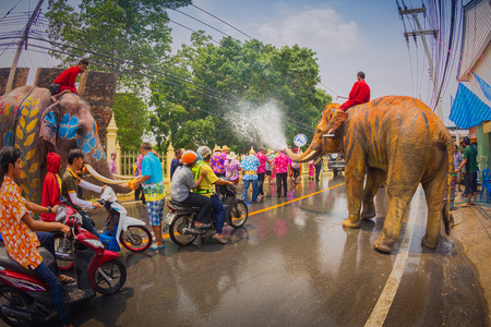 13 15 years: AYUTTHAYA, THAILAND - APRIL 13: Songkran Festival is celebrated in a traditional New Years Day from April 13 to 15, with the splashing water with elephants on April 13, 2014 in Ayuttaya, Thailand.