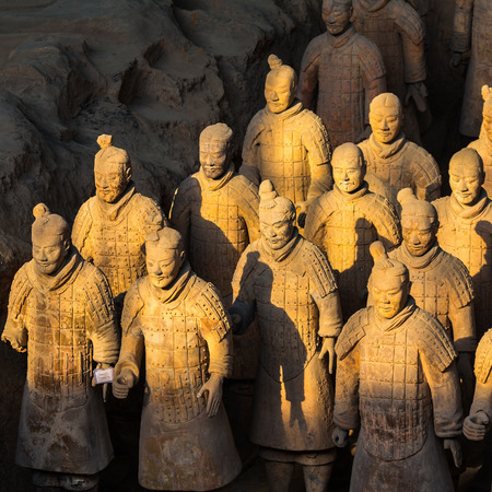 imperialism: XIAN,CHINA -MAR 24 :The Terracotta Army or the Terra Cotta Warriors and Horses buried in the pits next to the Qin Shi Huangs tomb in 210-209 BC. March 24, 2014 in Xian of Shaanxi Province, China.