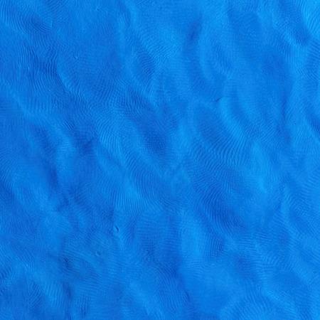 Plasticine finger textured blue color background