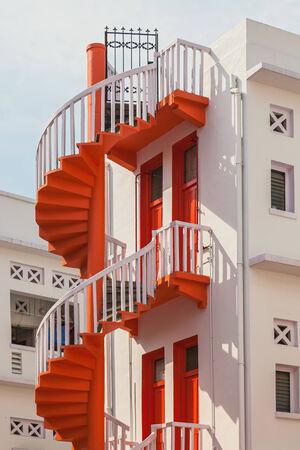 Red spiral stairs of Singapores Bugis Village  photo