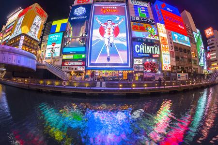 OSAKA, JAPAN - NOV 13: The Glico Man light billboard and other light displays on November 13, 2014 in Dontonbori, Namba Osaka area, Osaka, Japan. Namba is well known as an entertainment area in Osaka.