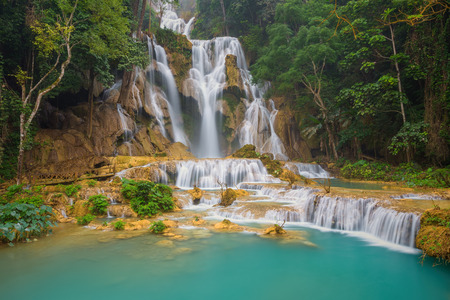 Kuang Si waterfall with blue minerals water in Luang Prabang province Laos photo