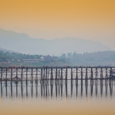 The wooden bridge is the second longest in the world. at morning in Sangklaburi Kanchanaburi, Thailand photo