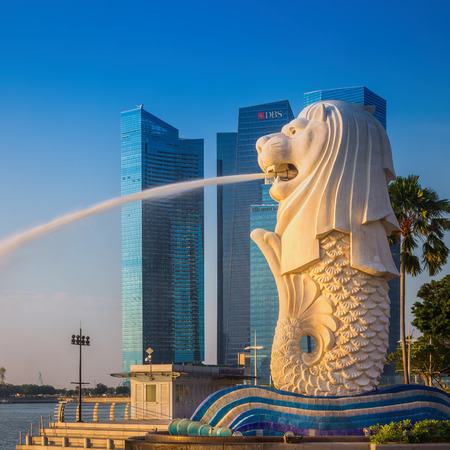 SINGAPORE-SEP 01, 2014: The Merlion fountain in front of the Marina Bay Sands hotel in Singapore. Merlion is a imaginary creature with the head of a lion,seen as a symbol of Singapore Editöryel