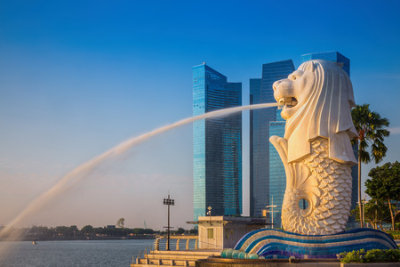SINGAPORE-SEP 01, 2014: The Merlion fountain in front of the Marina Bay Sands hotel in Singapore. Merlion is a imaginary creature with the head of a lion,seen as a symbol of Singapore Editorial