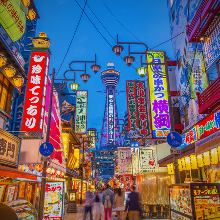 OSAKA, JAPAN - APRIL 18: Tsutenkaku Tower in Shinsekai (new world) district at night. Tsutenkaku tower and the area are developed in 1912 with New York and Paris as models. Taken on April 18 2015.