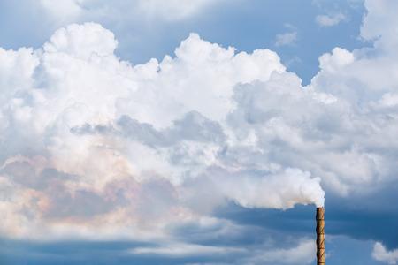 pipe smoking: Factory pipe smoking with a white smoke over the sky Stock Photo