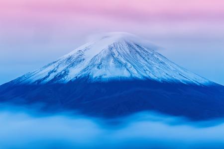 Mount Fuji enshrouded in clouds from lake kawaguchi, Yamanashi, Japan Stock Photo