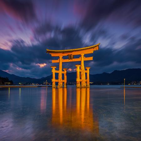 shinto: Great floating gate (O-Torii) on Miyajima island near Itsukushima shinto shrine, Japan shortly after the sunset