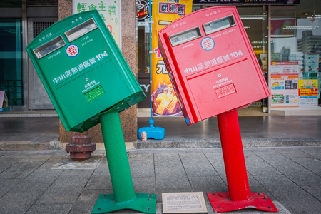 Taipei, Taiwan - March 8, 2016 : Two mailboxes, affectionately named Small Red and Small Green, are Taipeis newest tourist attraction after they were damaged by the recent typhoon Soudelor.