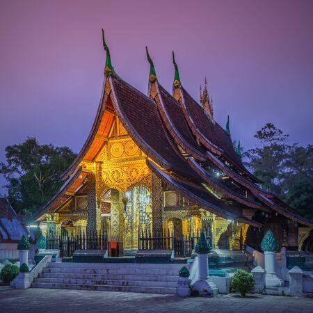 Wat Xieng thong temple at twilight time in Luang Pra bang, Laos.