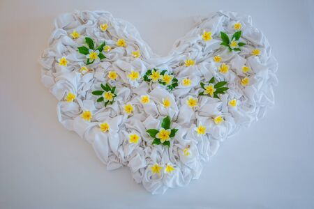 Closeup photo of bed sheet in shape of heart Stock Photo