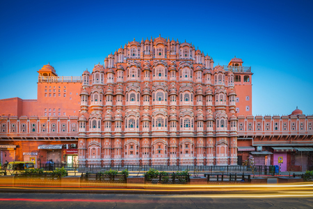 JAIPUR, INDIA - FEBRUARY 22, 2018 : Hawa Mahal is a five-tier harem wing of the palace complex of the Maharaja of Jaipur, built of pink sandstone in the form of the crown of Krishna