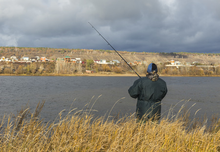 bank activities: fisherman on the river.