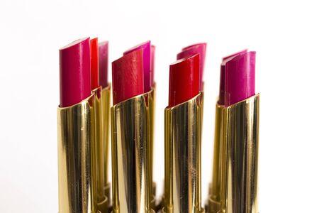 pomatum: Different lipsticks on white background.