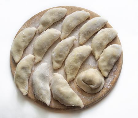 dumplings dumplings on a wooden circle.
