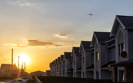 row of houses at sunset.