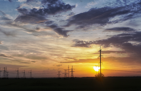 electric wires and towers at sunset.