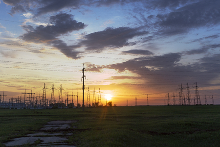 electric wires and towers at sunset