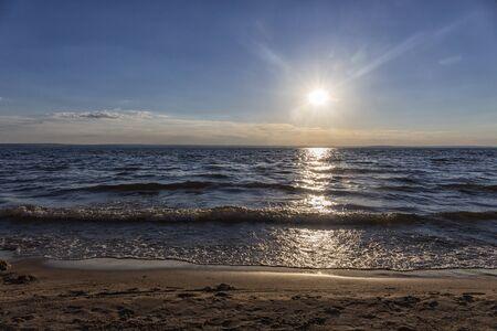 sunrise, sunset over the sea, ocean waves.
